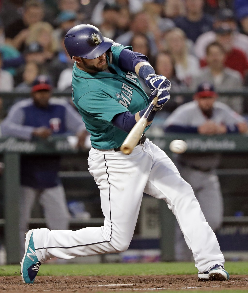 Seattle Mariners' Mitch Haniger singles in a run against the Minnesota Twins during the sixth inning of a baseball game Friday, May 25, 2018, in Seatt...