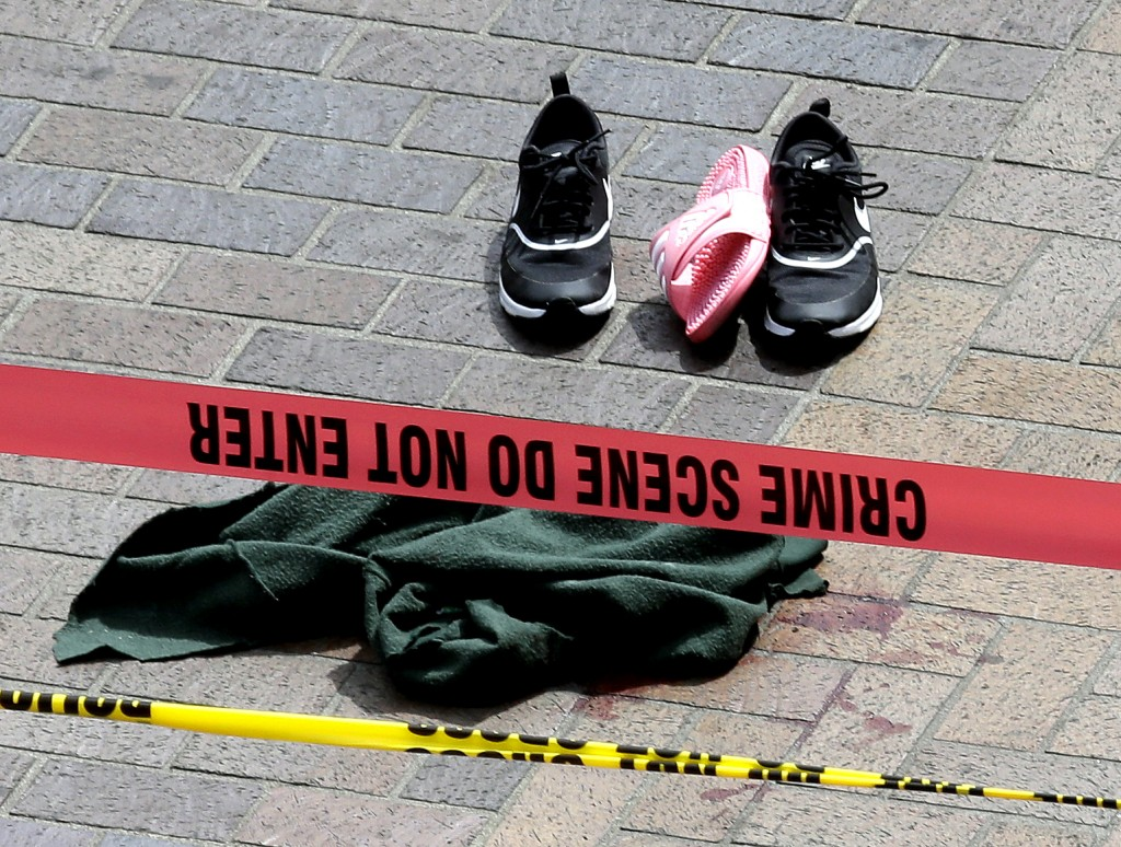 CORRECTS TO MOTORIST-Clothing is strewn on the sidewalk at a scene where pedestrians were hit by a motorist in Portland, Ore., Friday, May 25, 2018. P...