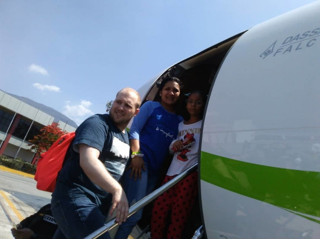 ADDS NAME OF DAUGHTER - In this image provided by the Holt family, Joshua Holt, his wife Thamara and her daughter Marian Leal, board a plane at the ai...