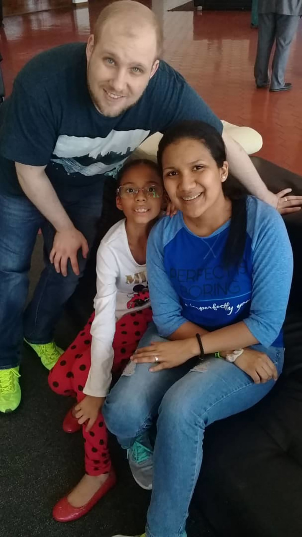 ADDS NAME OF DAUGHTER - In this image provided by the Holt family, Joshua Holt poses for a photo with his wife Thamara and her daughter Marian Leal, a...