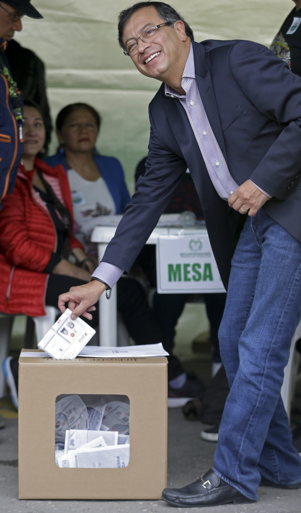 Gustavo Petro, presidential candidate for Colombia Humana, votes in the presidential election in Bogota, Colombia, Sunday, May 27, 2018. (AP Photo/Ric...