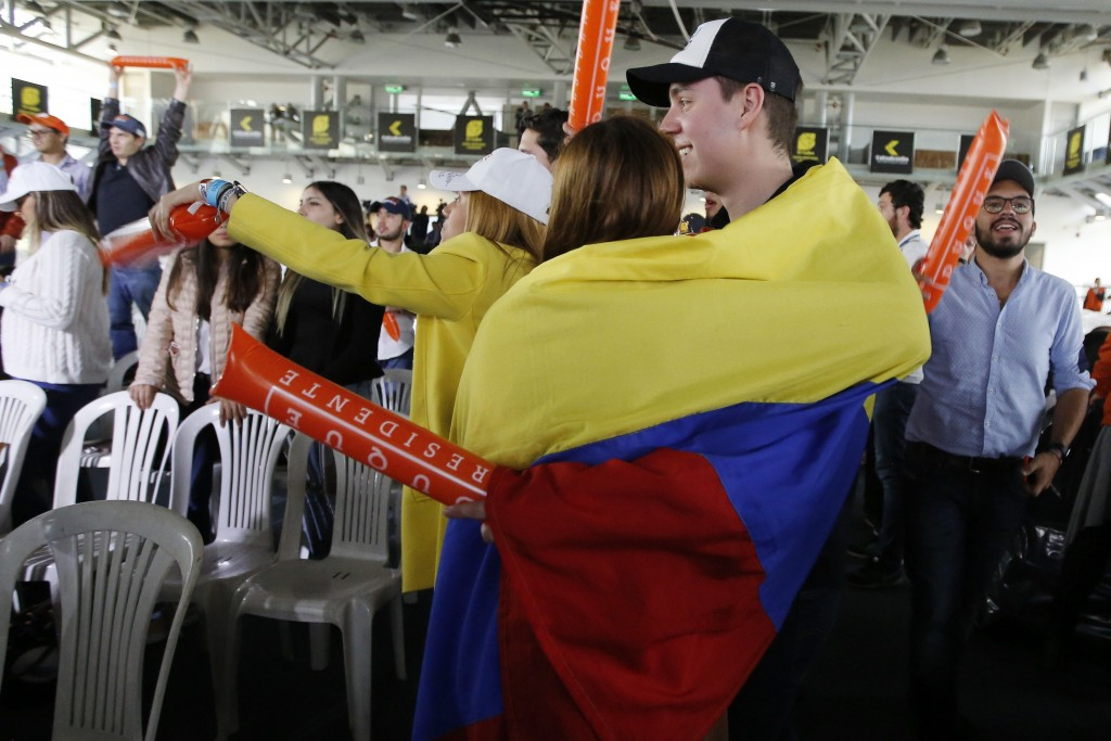 A couple of supporters of Ivan Duque, presidential candidate for the Democratic Center, follow presidential elections results at the candidate's headq...