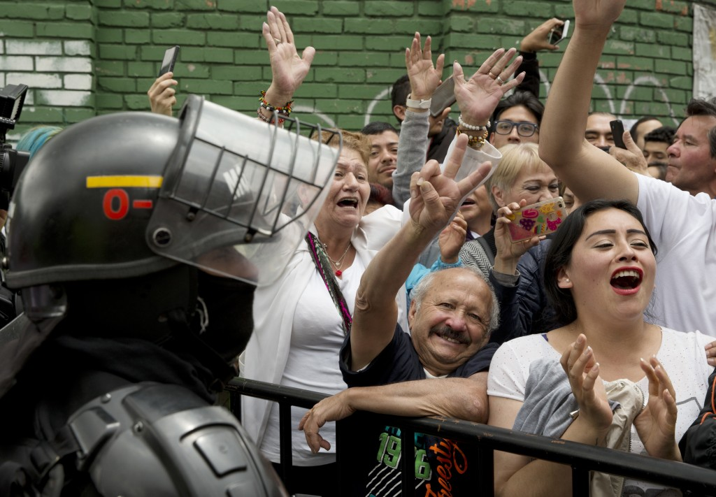Supporters of Gustavo Petro, presidential candidate for Colombia Humana, cheer as he leaves a polling station during the presidential election in Bogo...