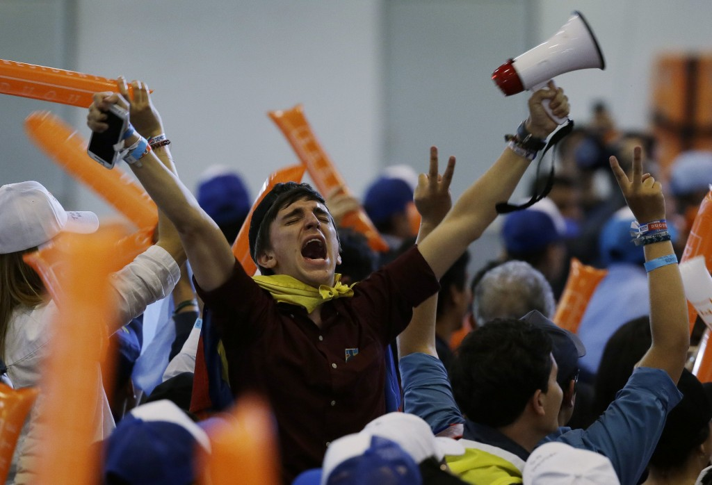 Supporters of Ivan Duque, presidential candidate for the Democratic Center, celebrate finishing first in presidential elections in Bogota, Colombia, S...