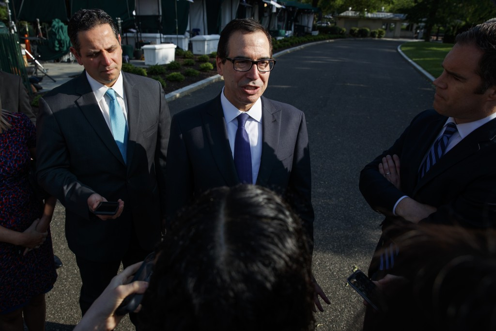 FILE - In this May 21, 2018, file photo, Treasury Secretary Steve Mnuchin talks with reporters about trade with China outside of the White House in Wa...