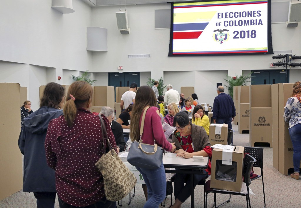 Colombians in Miami, Fla., vote in the first round of the presidential elections at Miami-Dade Wolfson Campus on Sunday, May 27, 2018. Even though the...