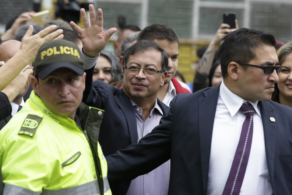Gustavo Petro, presidential candidate for Colombia Humana, arrives to vote in the presidential election in Bogota, Colombia, Sunday, May 27, 2018. (AP...