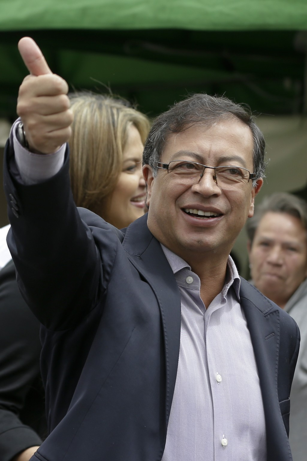 Gustavo Petro, presidential candidate for Colombia Humana, gives a thumbs up before voting in the presidential election in Bogota, Colombia, Sunday, M...