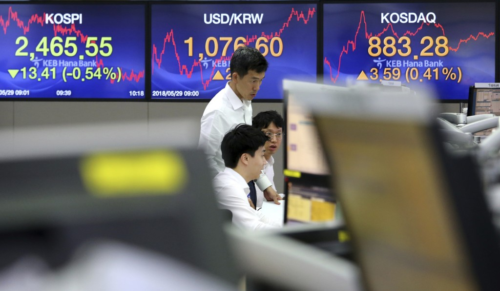 Currency traders watch monitors at the foreign exchange dealing room of the KEB Hana Bank headquarters in Seoul, South Korea, Tuesday, May 29, 2018. A...