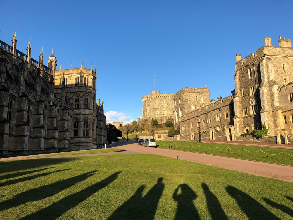 This March 2018 photo shows shadows of visitors lining up to hear evensong at St. George's Chapel at Windsor Castle in Windsor, England, where Prince ...