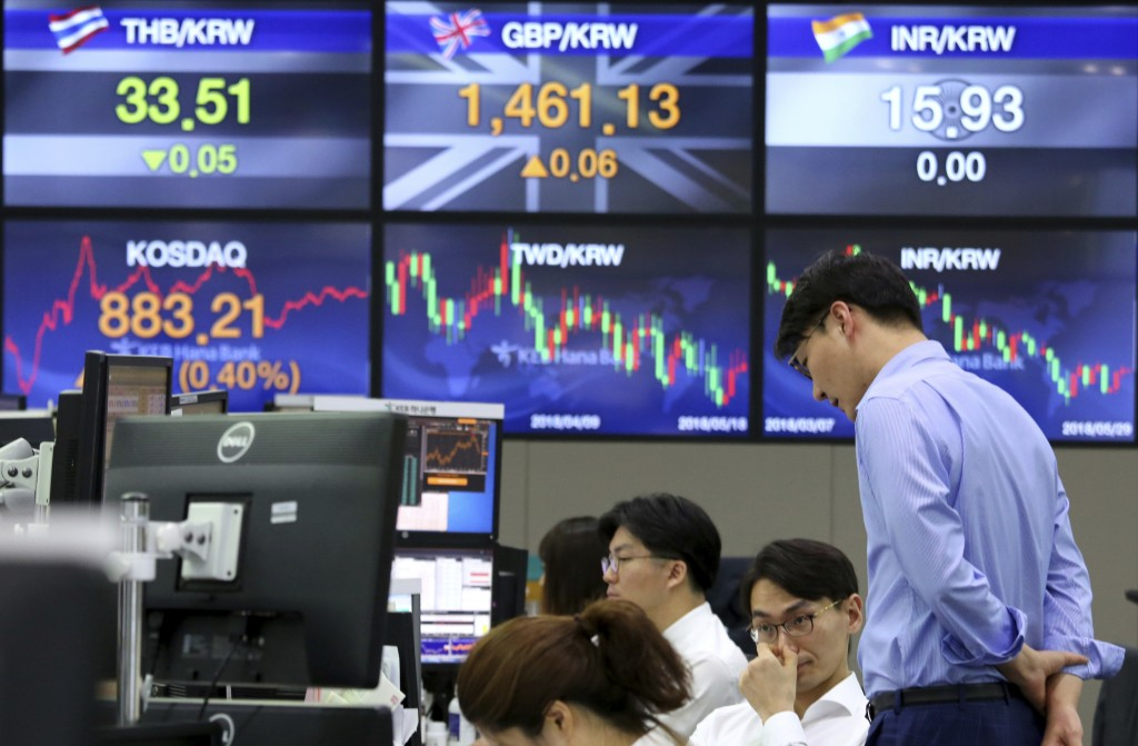 Currency traders work at the foreign exchange dealing room of the KEB Hana Bank headquarters in Seoul, South Korea, Tuesday, May 29, 2018. Asian stock...