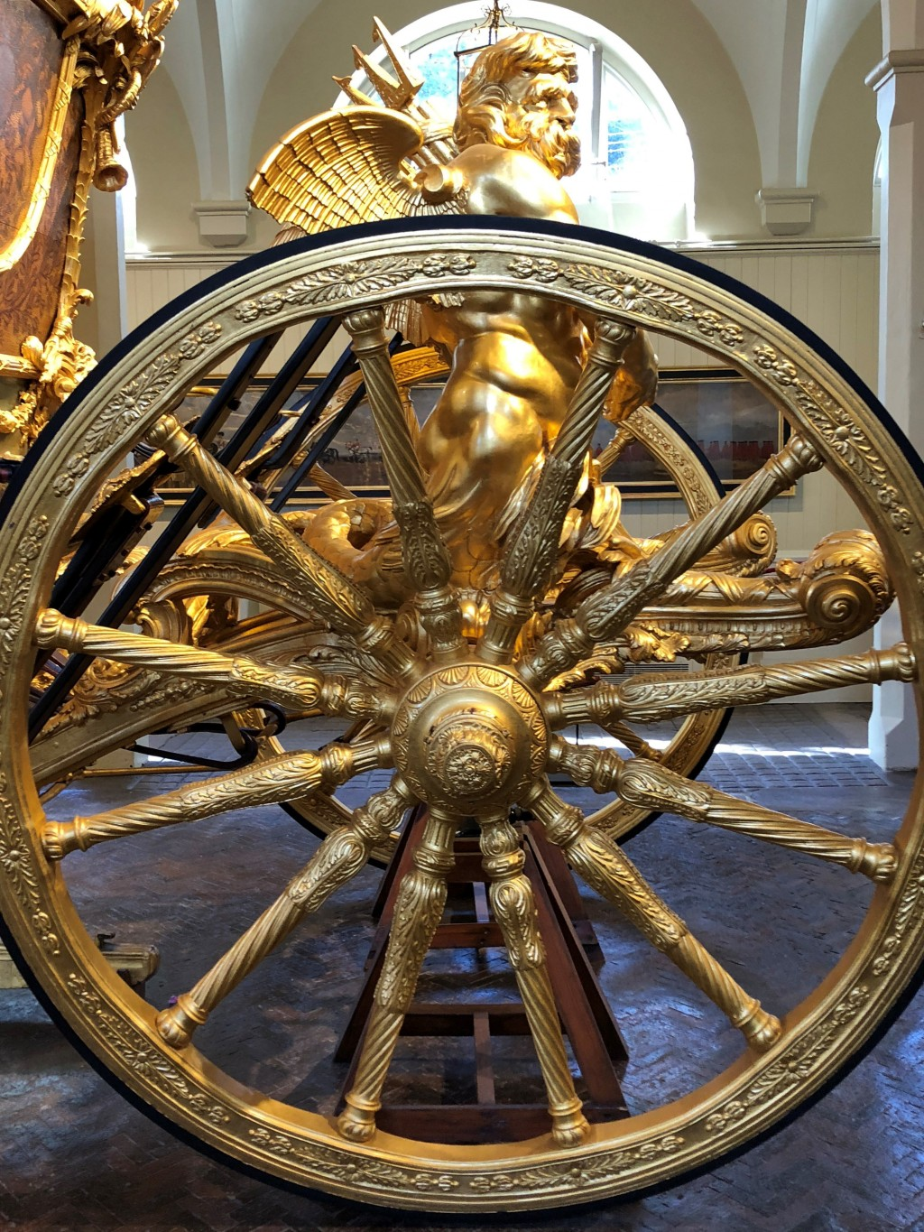 This March 2018 photo shows a detail from the gold state coach in the Royal Mews in London. The site houses stables, a carriage house and a garage for...