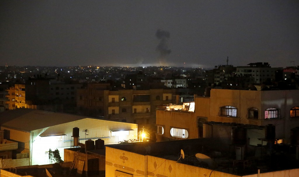 Smoke rises following an Israeli strikes on Gaza City, early Wednesday, May 30, 2018. Palestinian militants bombarded southern Israel with dozens of r...
