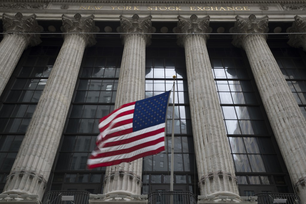 FILE- In this April 24, 2018, file photo, an American flag flies outside the New York Stock Exchange. Stocks are off to a mostly lower start on Wall S...