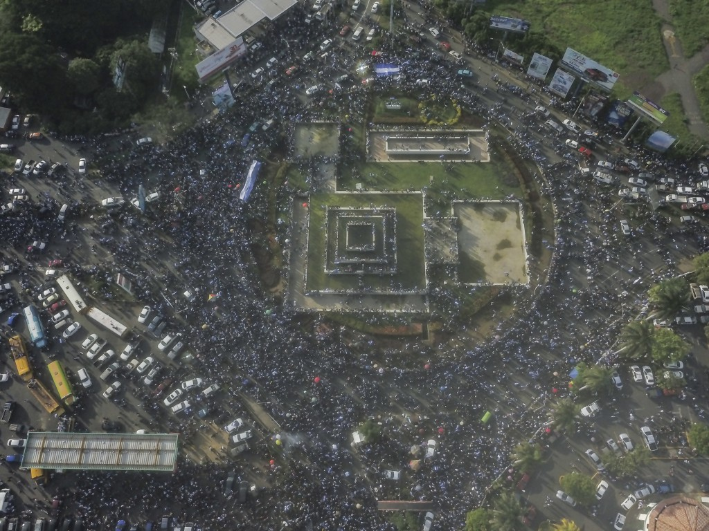 This aerial view shows of thousands of demonstrators in march against Nicaragua's President Daniel Ortega in Managua, Nicaragua, Wednesday, May 30, 20...