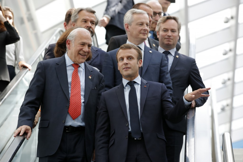 French President Emmanuel Macron, right, and Organisation for Economic Co-operation and Development (OECD) Secretary-General Angel Gurria arrive at th...