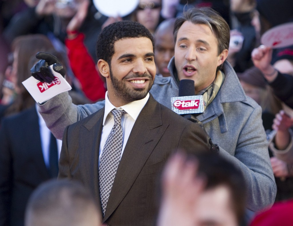 FILE - In this March 27, 2011 file photo, Drake arrives on the red carpet at the 2011 JUNO Awards, Canada's music awards in Toronto.  Drake is having