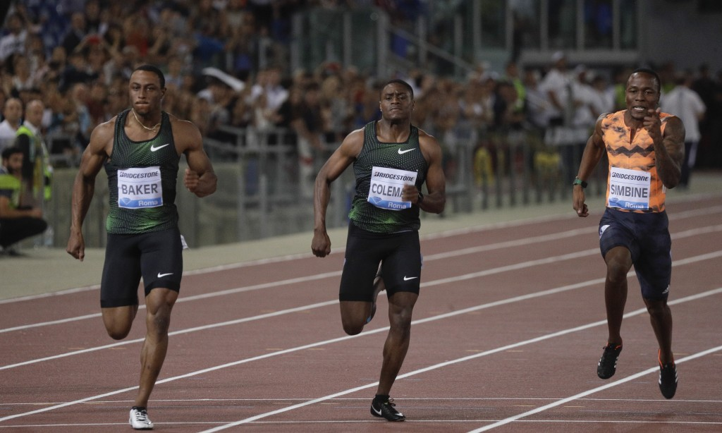 Ronnie Baker, of the United States, left, competes on his way to win the men's 100m event at the Golden Gala, the first European meeting of the Diamon...