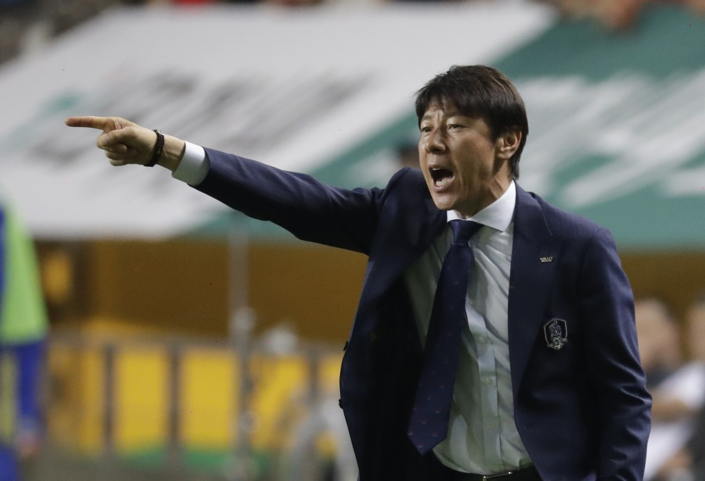 South Korea's head coach Shin Tae-yong gives instructions to his players during a friendly soccer match against Bosnia and Herzegovina at Jeonju World...