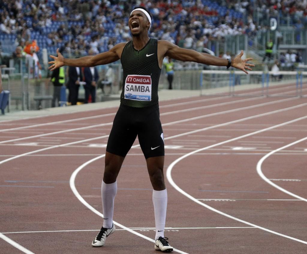 Qatar's Abderrahman Samba celebrates after winning the men's 400m hurdles, during the Golden Gala, the first European meeting of the Diamond League, a...