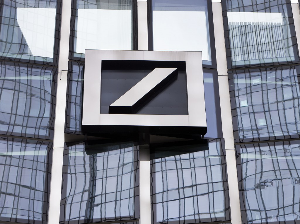 FILE - In this April 9, 2018, file photo the bank's logo is seen at a building of Deutsche Bank in Frankfurt, Germany. Shares of Deutsche Bank have tu...