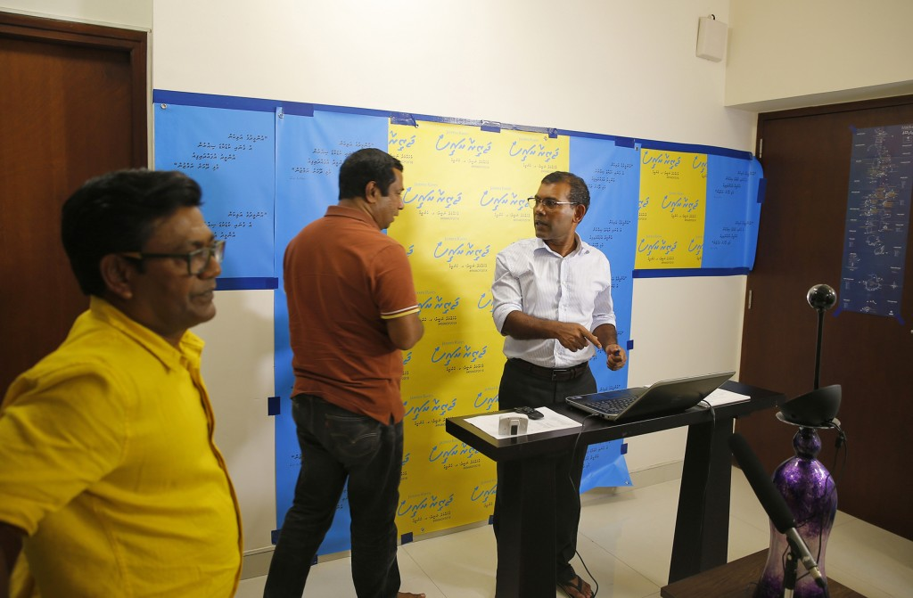 In this Thursday, May 31, 2018 photo, former Maldivian President Mohamed Nasheed interacts with supporters in Maldives through a Skype call from his r...