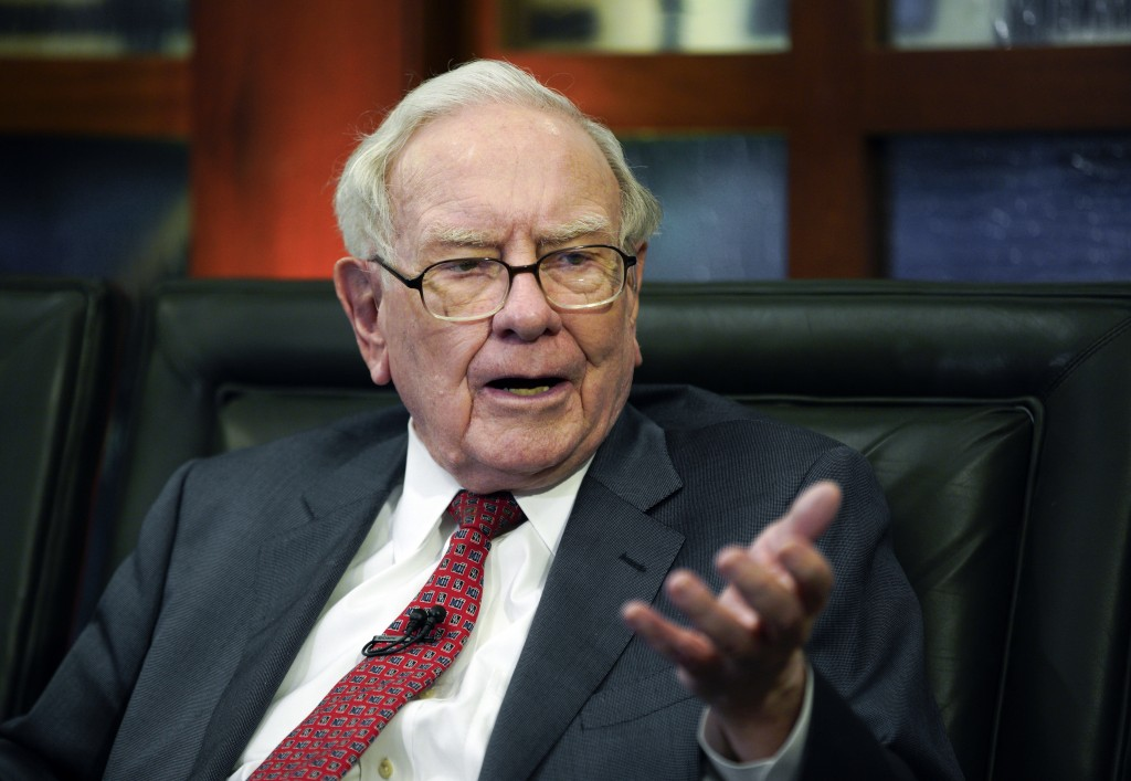 FILE - In this May 7, 2018 file photo, Berkshire Hathaway Chairman and CEO Warren Buffett speaks during an interview in Omaha, Neb. The price of a pri...