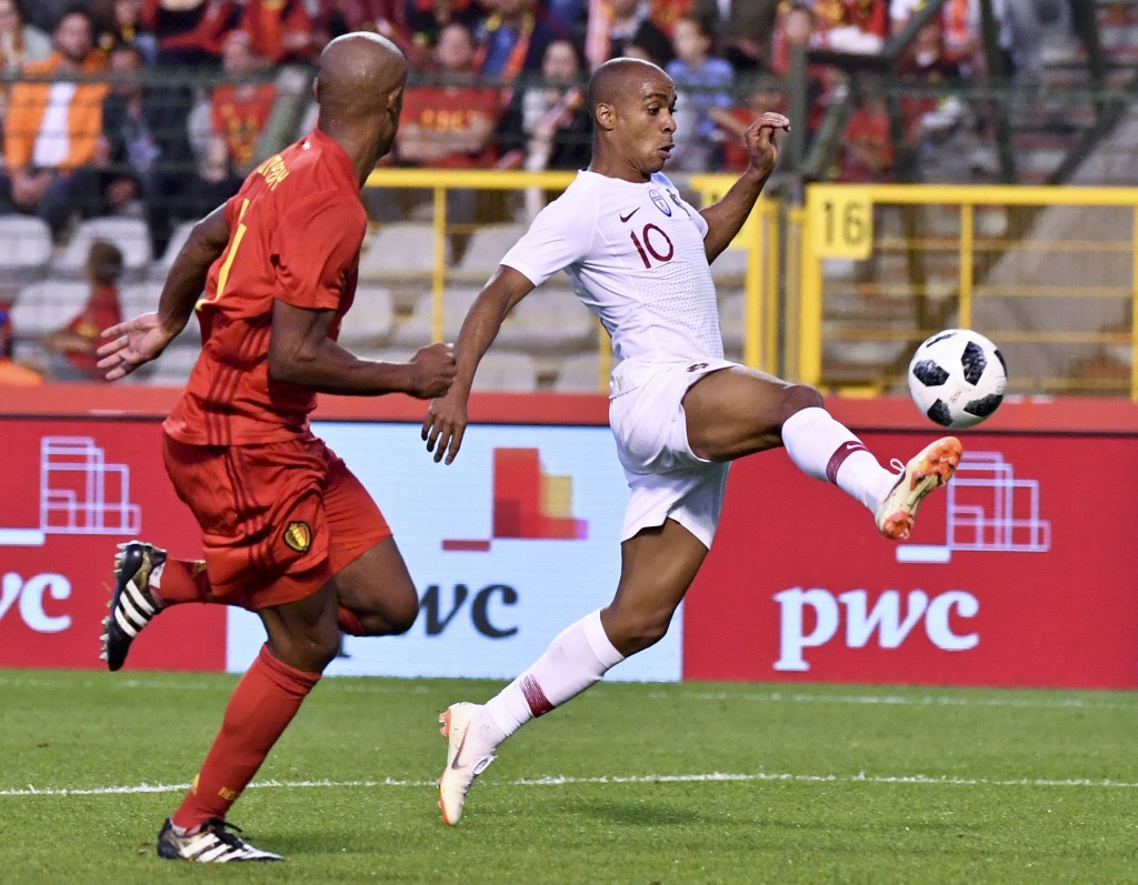 Portugal's Joao Mario, right, is chased by Belgium's Vincent Kompany during a friendly soccer match between Belgium and Portugal at the King Baudouin ...