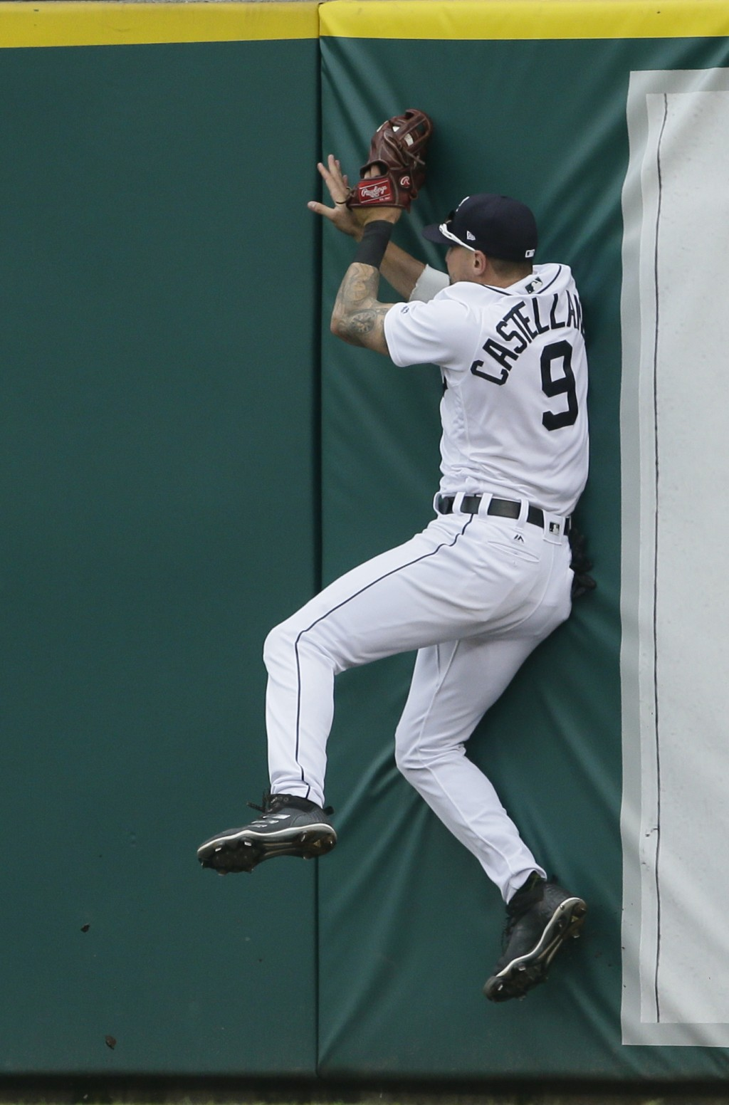 Detroit Tigers right fielder Nicholas Castellanos hits the right field wall after catching a fly ball hit by Toronto Blue Jays' Devon Travis during th...