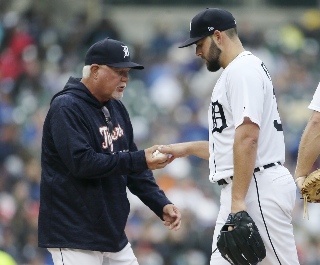Detroit Tigers manager Ron Gardenhire, left, pulls starting pitcher Michael Fulmer, right, during the seventh inning of a baseball game against the To...