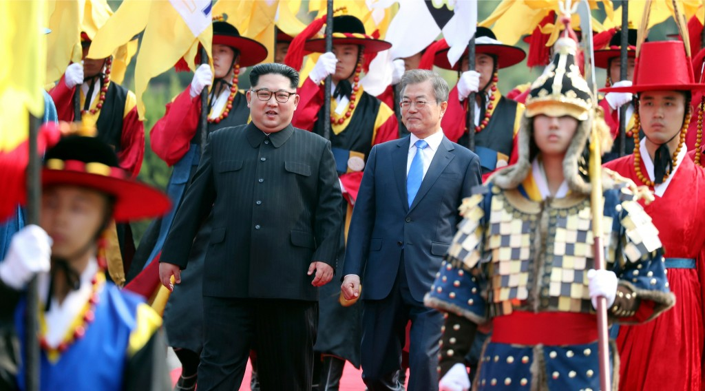 FILE - In this April 27, 2018, file photo, North Korean leader Kim Jong Un, left, and South Korean President Moon Jae-in, right, walk together through
