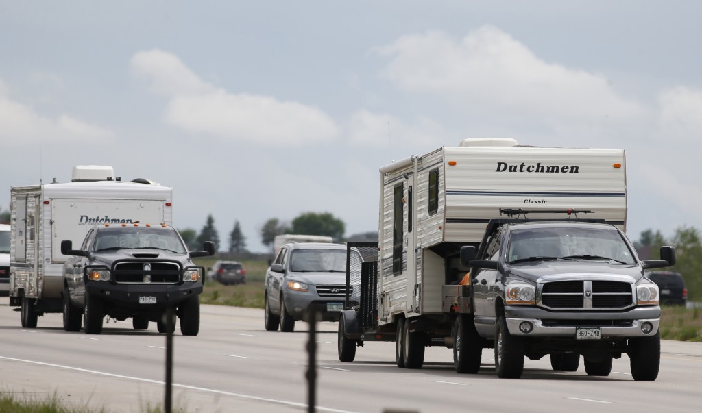 FILE - In this May 27, 2016, file photo, motorists guide their vehicles northbound on Interstate 25 to mark the start of the Memorial Day weekend near...