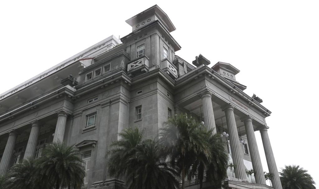 This May 30, 2018, image made from video shows the Fullerton Hotel in Singapore. Speculation over how North Korea will handle the bill for North Korea