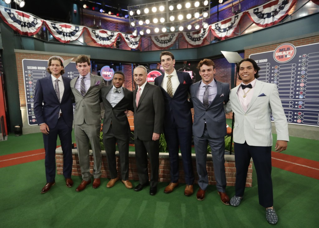 Baseball commissioner Rob Manfred, center, poses for photographs with draft prospects Alec Bohm, left, Triston Casas, second from left, Xavier Edwards...