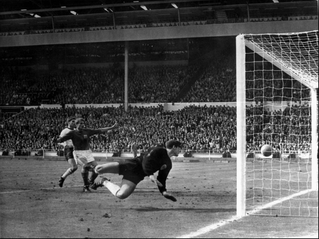 FILE - In this July 30, 1966 file photo, a shot from Geoff Hurst bounces down from the West Germany crossbar during the World Cup final at London's We...