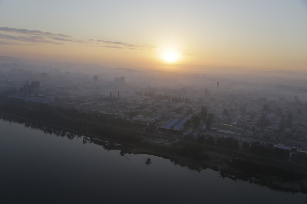 FILE - Apartment buildings peep out of the morning mist as the sun rises over Pyongyang, North Korea, on Aug. 28, 2014. (AP Photo/Wong Maye-E, File)