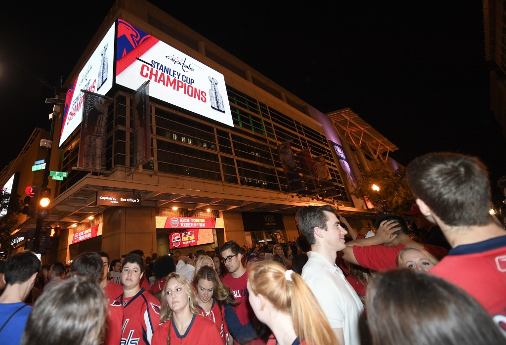 fff64347e74 ... Stanley Cup Final between. Washington Capitals fans clog the streets  outside Capital One Arena in Washington after Game 5 of