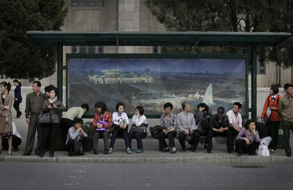 FILE - Commuters wait for a trolley bus to arrive in downtown Pyongyang, North Korea, on May 3, 2015. (AP Photo/Wong Maye-E, File)