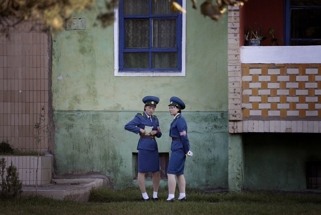 FILE - Traffic policewomen chat next to a residential building while off duty in Pyongyang, North Korea, on Oct. 18, 2016. (AP Photo/Wong Maye-E, File...
