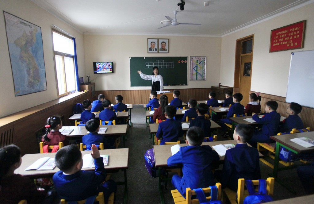 FILE - Students attend their first day of class at the Ryonhwa primary school in Pyongyang, North Korea, on April 2, 2018. (AP Photo/Jon Chol Jin, Fil...
