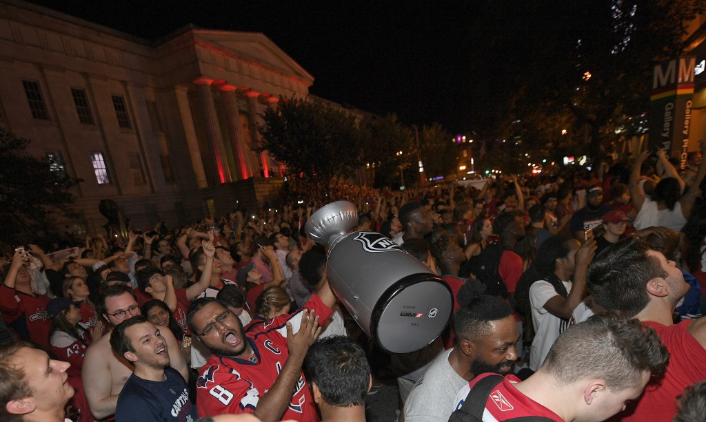 406c69553db ... Stanley Cup Final between the Capital. Washington Capitals fans celebrate  in the streets outside Capital One Arena after Game 5 of the