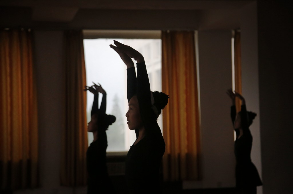 FILE - Girls are silhouetted during a dance class at the Mangyongdae Children's Palace in Pyongyang, North Korea, on May 7, 2015. The Children's Palac...
