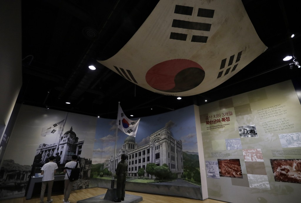 In this June 8, 2018, photo, students visit the exhibition hall of the Korean War at the War Memorial of Korea in Seoul, South Korea. Long a dream of ...