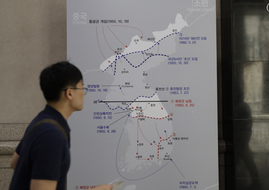 In this June 8, 2018 photo, a man walks by a map of the Korean war at the War Memorial of Korea in Seoul, South Korea. Long a dream of Koreans on both...