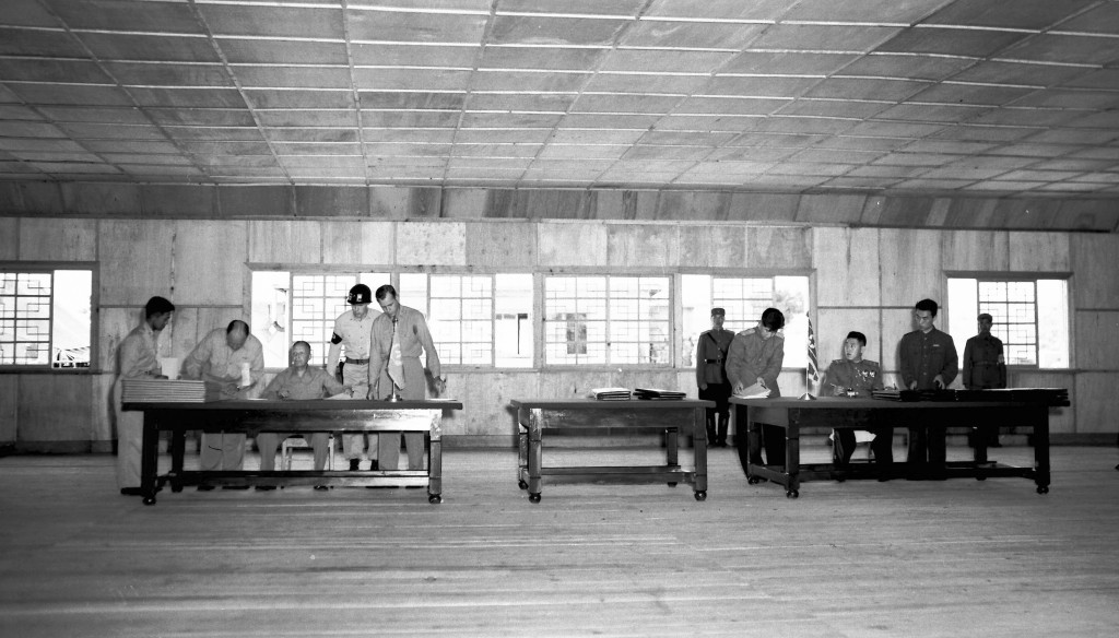 FILE - In this July 26, 1953, file photo, Gen. William K. Harrison, Jr., seated at left, and North Korean Gen. Nam Il, seated at right, sign armistice...