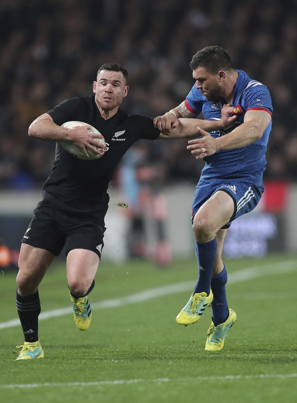 Ryan Crotty, left, of New Zealand is tackled by Remy Grosso of France during their rugby test in Auckland, New Zealand, Saturday, June 9, 2018. (AP Ph