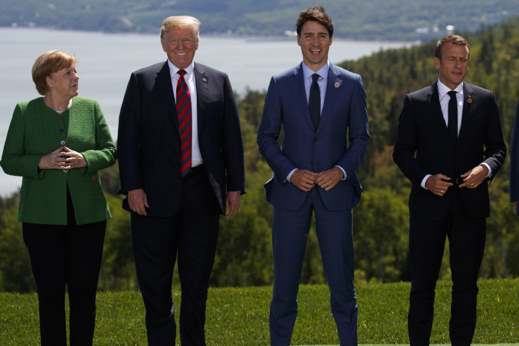 German Chancellor Angela Merkel President Donald Trump Canadian Prime Minister Justin Trudeau and French President Emmanuel Macron gather for the