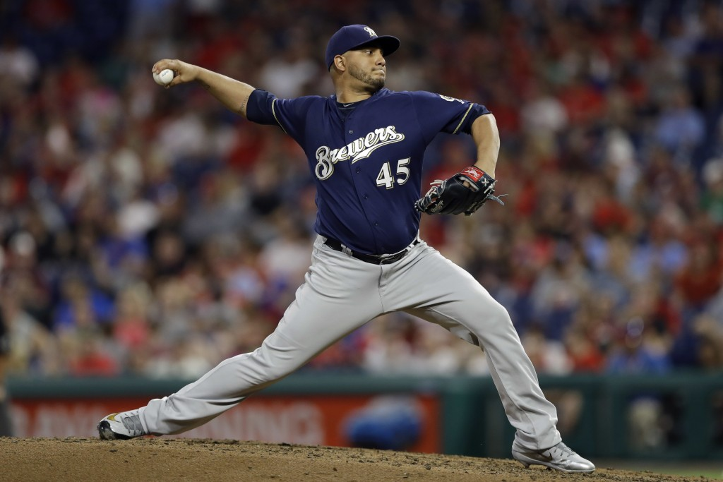 Milwaukee Brewers' Jhoulys Chacin pitches during the fourth inning of a baseball game against the Philadelphia Phillies, Friday, June 8, 2018, in Phil...