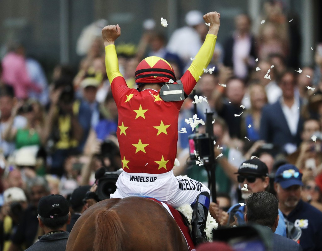 Jockey Mike Smith reacts after guiding Justify to win the 150th running of the Belmont Stakes horse race Saturday