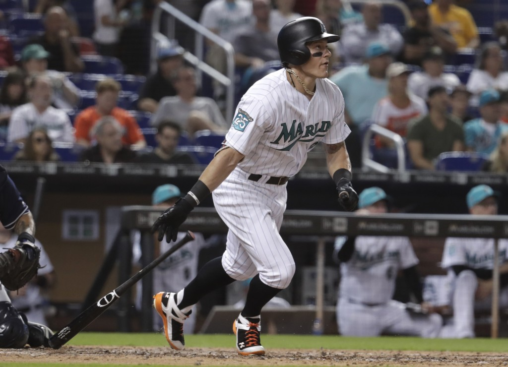 0d4edc11 Miami Marlins' Derek Dietrich watches his solo home run during the sixth  inning of a